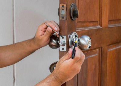wood door and locksmith maintain silver knob