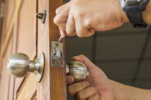 locksmith repair silver lock on wood door