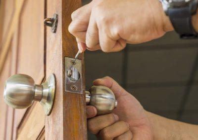 locksmith repair silver lock on wood door